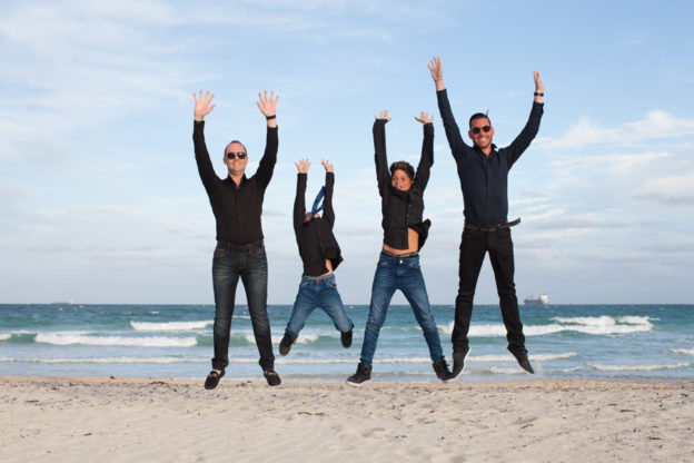 Family jumping Miami Beach