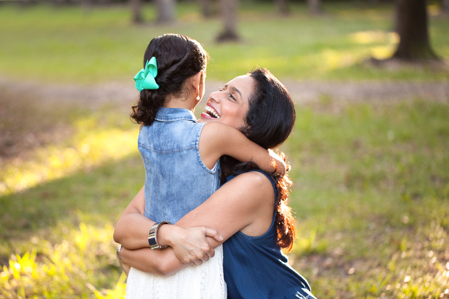 Mother laughing with daughter Coral Gables photo session