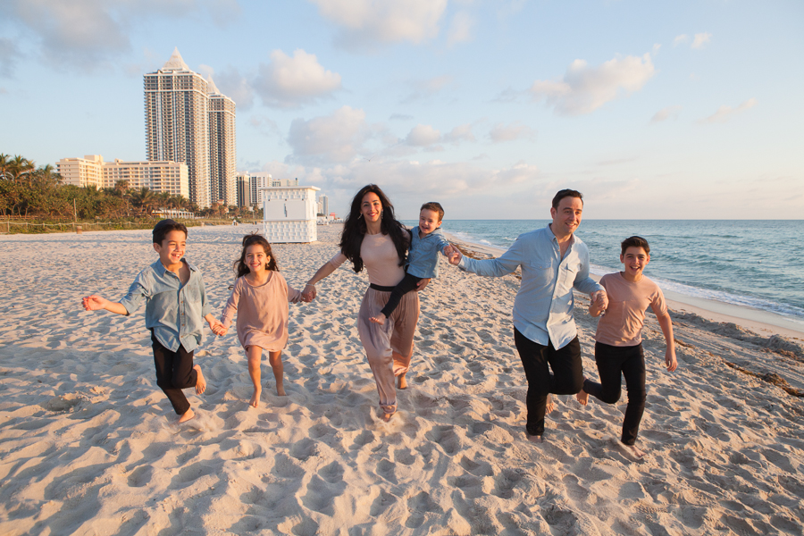 Family running Miami Beach