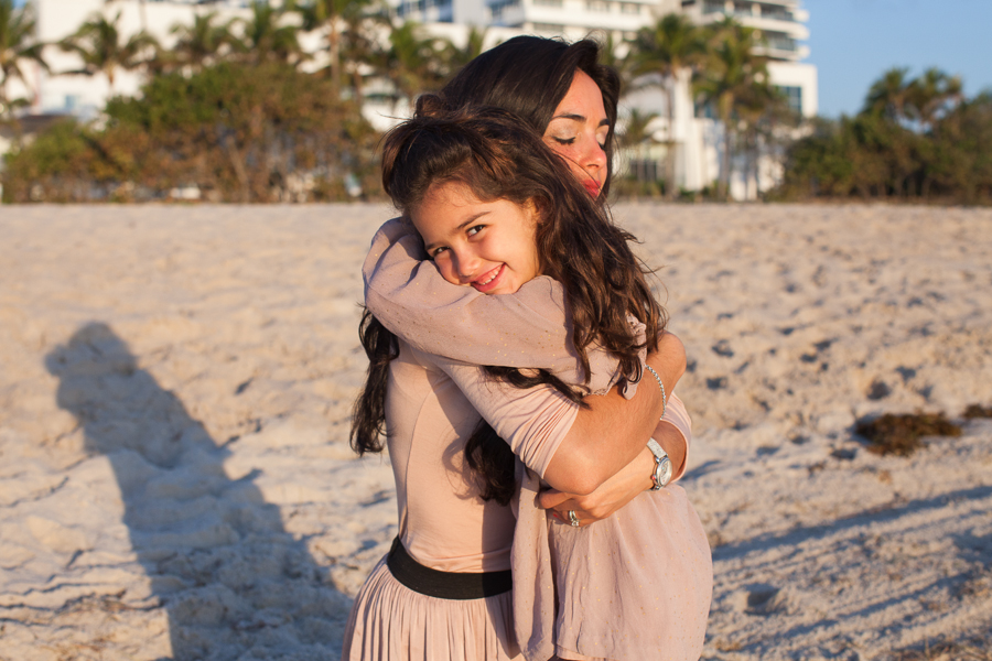 mother daughter hug miami