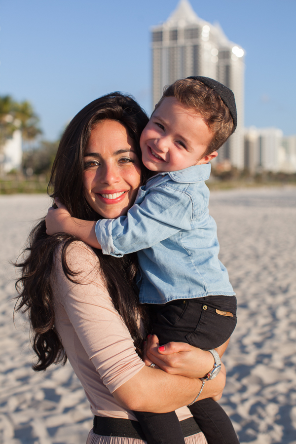 mother hugging son miami beach