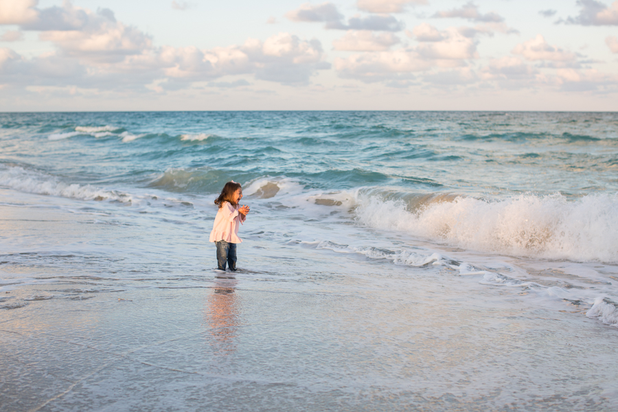 Girl playing in ocean Miami Beach