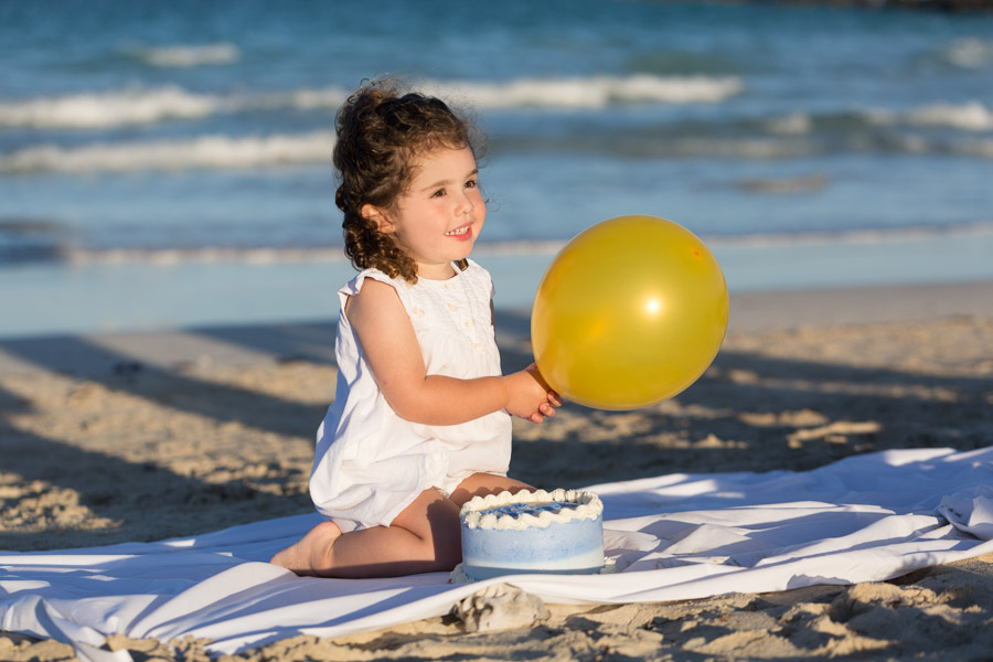 Cake smash on the beach family photography session