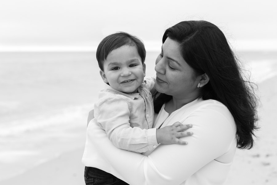 mother son on beach black and white