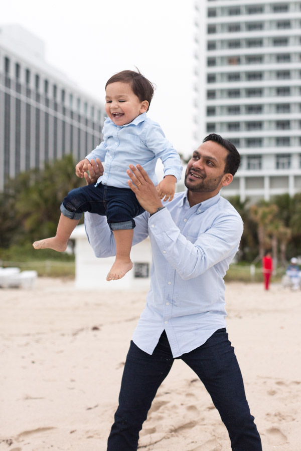 father tossing son in miami