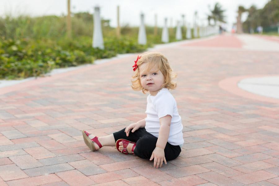 daughter sitting miami beach boardwalk