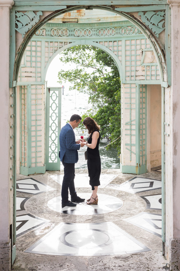 Putting the ring on her finger in Vizcaya's Tea house