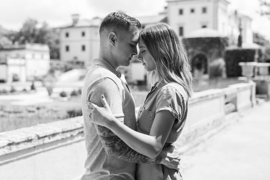 black and white couple pose leaning foreheads