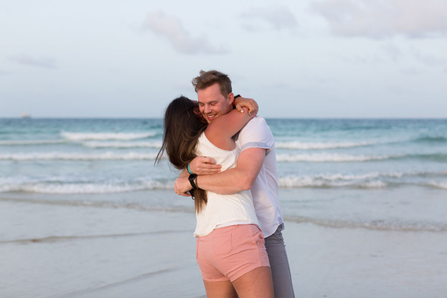 couple hugging beach
