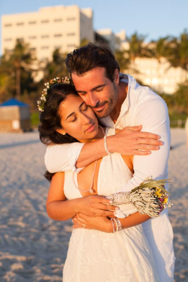 couple hugging miami elopement