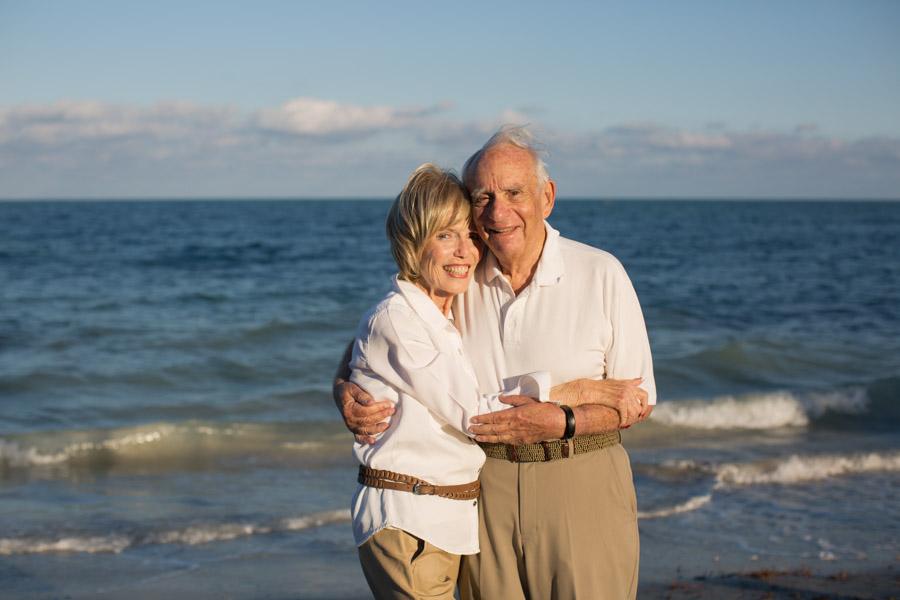 elderly couple hugging key biscayne beach