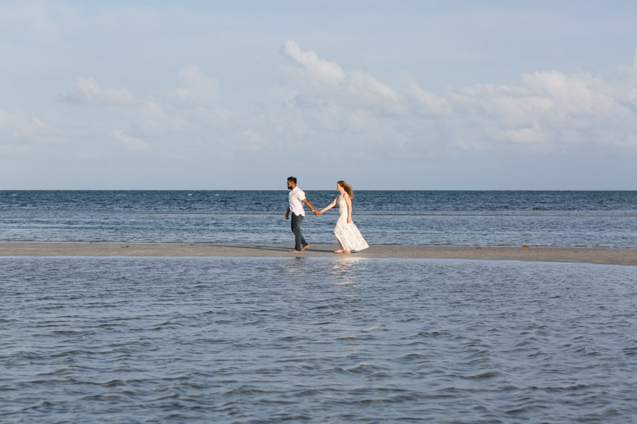 couple walking on key biscayne beach
