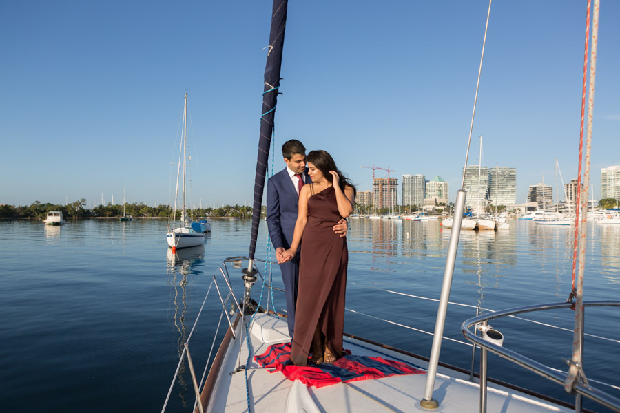 couple engagement on boat in coconut grove