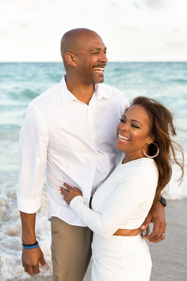 couple laughing by beach