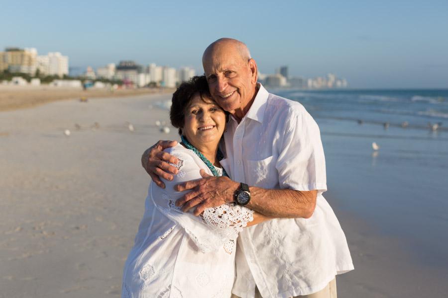 older couple hugging sunrise